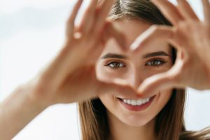 Visioning Client looking through with heart made with fingers