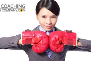 Motivated Leader wearing red boxing gloves